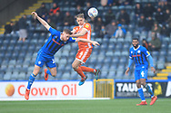 Callum Camps wins a challenge during the EFL Sky Bet League 1 match between Rochdale and Shrewsbury Town at Spotland, Rochdale, England on 9 March 2019.