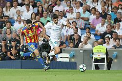 August 27, 2017 - Madrid, Spain - Carlos Soler and Marco Asensio. LaLiga Santander matchday 2 between Real Madrid and Valencia. The final score was 2-2, Marco Asensio scored twice for Real Madrid. Carlos Soler and Kondogbia did it for Valencia. Santiago Bernabeu Stadium, august 27, 2017. Photo by  (Credit Image: © |Antonio Pozo |  Media Expre/VW Pics via ZUMA Wire)