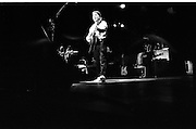 """Paul Simon In Concert.  (R54)..1987..16.04.1987..04.16.1987..16th April 1987..As part of his world tour of """"Graceland"""", Paul Simon took to the stage of the RDS last night. A packed house was treated to songs from his current album as well as some classics from the Simon and Garfunkel catalogue...Picture shows Paul Simon performing a song from his album """"Graceland"""" on stage at the RDS."""