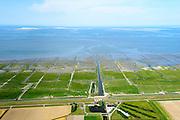 Nederland, Groningen, Gemeente Eemsmond, 05-08-2014; Noordpolderzijl met gemaal en uitwaterende sluis. Noordpolder ten noorden van Usquert. Rottermeroog en Rottermerplaat aan de horizon.<br /> Bij het op deltahoogte brengen van de zeedijk is de oude sluis dichtgemetseld en deze maakt nu deel uit van het landart mozaiek.<br /> Noordpolderzijl pumping station and sluices. When the seawall was strengthened the old lock disappeared, it is now part of the landart mosaic. <br /> <br /> luchtfoto (toeslag op standard tarieven);<br /> aerial photo (additional fee required);<br /> copyright foto/photo Siebe Swart