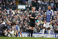 Jay Bothroyd of Cardiff City has a word with referee G K Hegley after Joe Ledley (l) was brought down by Wes Morgan. Coca cola championship, Cardiff City v Nottingham Forest at Ninian Park in Cardiff on Sat 31st Jan 2009..pic by Andrew Orchard, Andrew Orchard sports photography,