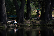 Berlin, Germany - August 31, 2015: People enjoy a hot summer day in the Tiergarten, a 210-hectare (520-acre) park in the center of Berlin, Germany.