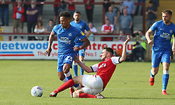 Tyler Denton of Peterborough United in action with Lewis Coyle of Fleetwood Town - Mandatory by-line: Joe Dent/JMP - 19/04/2019 - FOOTBALL - Highbury Stadium - Fleetwood, England - Fleetwood Town v Peterborough United - Sky Bet League One