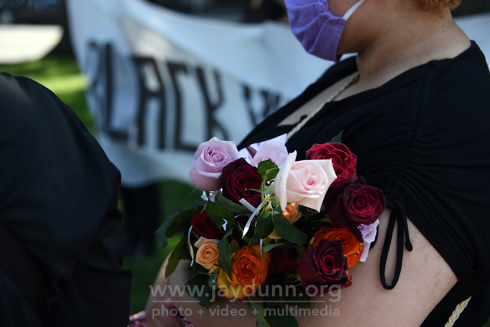 """Determined to keep continuing racial injustice in the public eye, a small but well-organized group of protesters held a July 4th """" March for Liberty and Justice for All"""" in Waterbury, CT,  gracing each individual murdered with roses in an urgent, emotional appeal. Photograph by Jay Dunn."""