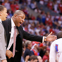 11 May 2014: Los Angeles Clippers head coach Doc Rivers talks to Los Angeles Clippers guard Chris Paul (3) next to assistant coach Tyronn Lue during the Los Angeles Clippers 101-99 victory over the Oklahoma City Thunder, during Game Four of the Western Conference Semifinals of the NBA Playoffs, at the Staples Center, Los Angeles, California, USA.