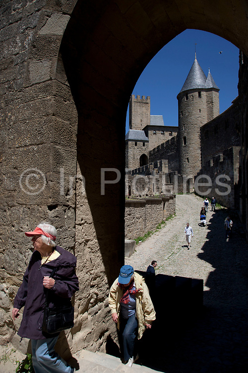 Inner and outer walls. The Cité de Carcassonne is a medieval fortified walled town located in the French city of Carcassonne, in the department of Aude, in the region of Languedoc-Roussillon.