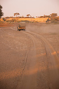 Land rover driving down dirt track, The Kaokoveld Desert, Kaokoland, Northern Namibia, Southern Africa