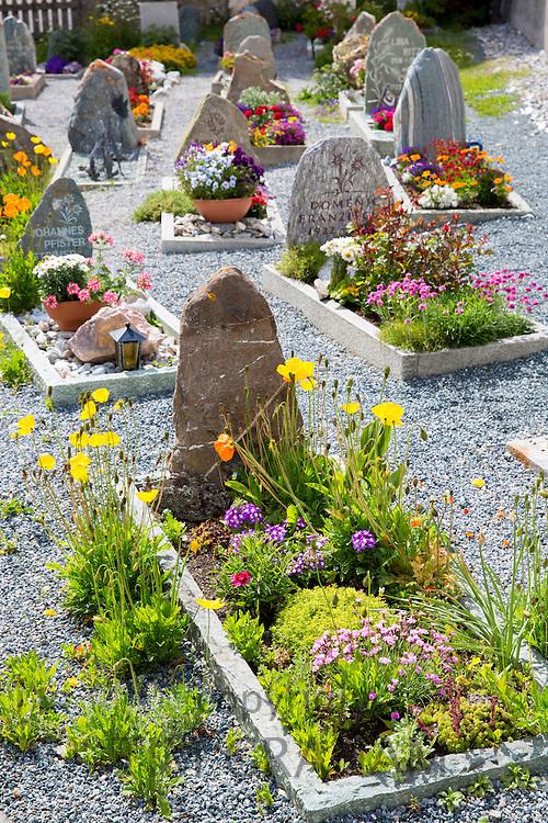 Churchyard in the Engadine Valley village of Guarda, Switzerland
