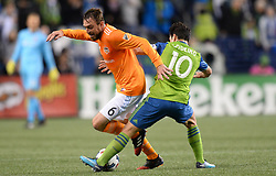 November 30, 2017 - Seattle, Washington, U.S - Soccer 2017: NICOLAS LODEIRO (10) and ERIC ALEXANDER (6) in action as the Houston Dynamo play the Seattle Sounders in the 2nd leg of the MLS Western Conference Finals match at Century Link Field in Seattle, WA. Seattle won the match 3-0. (Credit Image: © Jeff Halstead via ZUMA Wire)