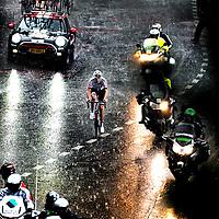 Frankrijk, Andorra Arcalis, 10-07-2016<br /> Wielrennen, Tour de France, 9e etappe.<br /> Van Vielha Val D'Aran naar Andorra Arcalis.<br /> Tom Dumoulin tijdens de beklimming van de Andorra Arcalis in de stromende regen en de dikke hagelstenen en op weg naar de ritzege.<br /> Foto: Klaas Jan van der Weij