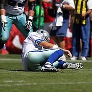 Dallas Cowboys quarterback Tony Romo (9) gets injured by San Francisco 49ers cornerback Carlos Rogers (22) during an NFL football game between the Dallas Cowboys and the San Francisco 49ers at Candlestick Park on Sunday, Sept. 18, 2011 in San Francisco, CA.   (Photo/Alex Menendez)