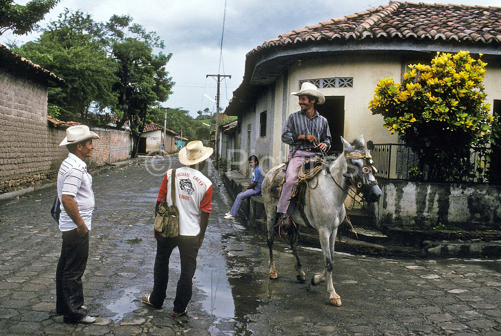 Cattle farmers passing through the village of Anamoros, El Salvador.