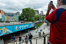 © Licensed to London News Pictures. 22/06/2021. LONDON, UK. A Czech fan takes a photo ahead of the Euro 2020 Group D match between Czech Republic and England at Wembley Stadium.  Wembley Stadium will host the semi-finals and final with 75% capacity being allowed per the UK government, which equates to just over 60,000 spectators, the most allowed at a major sporting event since the pandemic began.  Photo credit: Stephen Chung/LNP