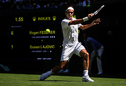 LONDON, July 2, 2018  Roger Federer of Switzerland hits a return during the men's singles first round match against Dusan Lajovic of Serbia at the Championship Wimbledon 2018 in London, Britain, on July 2, 2018. Roger Federer won 3-0. (Credit Image: © Shi Tang/Xinhua via ZUMA Wire)