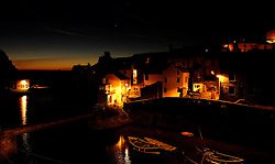© Licensed to London News Pictures.02/10/15<br /> Staithes, UK. <br /> <br /> Street lights shine on houses as dawn breaks in the North Yorkshire village of Staithes on the east coast as the warm autumn weather continues.<br /> Photo credit : Ian Forsyth/LNP