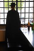 woman in black cape and hat sandeman port lodge vila nova de gaia porto portugal