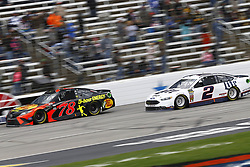 April 8, 2018 - Ft. Worth, Texas, United States of America - April 08, 2018 - Ft. Worth, Texas, USA: Martin Truex, Jr (78) and Brad Keselowski (2) battle for position during the O'Reilly Auto Parts 500 at Texas Motor Speedway in Ft. Worth, Texas. (Credit Image: © Chris Owens Asp Inc/ASP via ZUMA Wire)