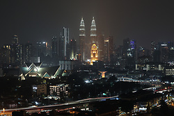 March 30, 2019 - Kuala Lumpur, Kuala Lumpur, Malaysia - A Malaysian landmark  Petronas Twin Towers , are pictured after lights were turned on after the Earth Hour March 30, 2019. The event is held annually encouraging individuals, communities, and businesses to turn off non-essential electric lights for one hour, from 8:30 to 9:30 p.m. on a specific day towards the end of March, as a symbol of commitment to the planet. (Credit Image: © Kepy/ZUMA Wire)