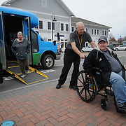 "11/17/11 -- BRUNSWICK, Maine. Driver Gregory Guckenburg, 62, assists Pam Boucher, 59, of Brunswick with getting off of the Brunswick Explorer.  ""If it wasn't for this bus we wouldn't get out to anywhere,"" said Boucher. Boucher and her friend, Becky Estabrook, 58, in the door, who travels with her, were very positive about the bus, which seats as many as 15 people, including Boucher, who uses a wheelchair lock-in system. Photo by Roger S. Duncan."