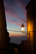 "Sunset and Lamplight, Erice, Sicily. (c) Dave Walsh 2013 This mage can be licensed via Millennium Images. Contact me for more details, or email mail@milim.com For prints, contact me, or click ""add to cart"" to some standard print options."
