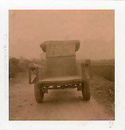 Polaroid chocolate 80 picture of an old truck's rear. It's going on countryside road. Guangxi province, China, Asia.