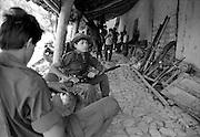 Child guerrillas in El Salvador. Photographer Glen Huitt films in the background.