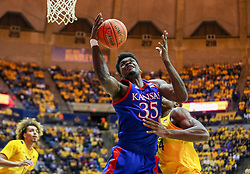 Feb 12, 2020; Morgantown, West Virginia, USA; Kansas Jayhawks center Udoka Azubuike (35) receives a pass in the lane while defended by West Virginia Mountaineers forward Oscar Tshiebwe (34) during the first half at WVU Coliseum. Mandatory Credit: Ben Queen-USA TODAY Sports