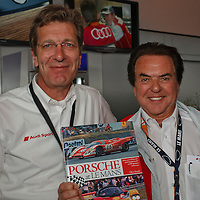 Joest Racing's technical director Ralf Juttner (left) and team principal Reinhold Joest (right) hold a copy of Glen Smale's book 'Porsche at Le Mans', for which Reinhold Joest wrote the Foreword, Le Mans 2011