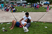 A couple embraces during a party in the main square of Boca Colorado, Peru. Boca Colorado is a town formed entirely by mining activity in the Peruvian Amazon.