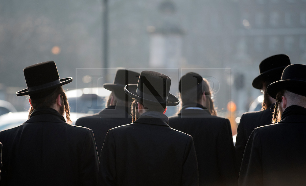 © Licensed to London News Pictures. 22/01/2015. London, UK Orthodox Jews visiting the Queen Victoria Monument in London on 22 January 2015. Photo credit : Stephen Simpson/LNP