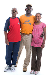 Portrait of a father and teenage children in the studio,