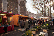Market in the Pastor-Konn-Plastz square outside St Aposteln church, Cologne.