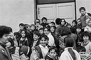 """Residents at the Varazdin refugee camp in Croatia in the winter of 1992. The waving boy in the middle The boy waving in the middle is """"Elvis""""."""