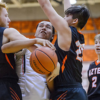 Gallup Bengal Troy Etsitty (42) is fouled by Aztec Tiger Chase Morrison (23) Saturday at Gallup High School.