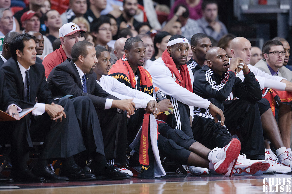 17 November 2010: Miami Heat's shooting guard #3 Dwyane Wade and Miami Heat's small forward #6 LeBron James are seen on the bench next to Miami Heat's shooting guard #42 Jerry Stackhouse, Miami Heat's center #11 Zydrunas Ilgauskas, Miami Heat's point guard #15 Mario Chalmer during the Miami Heat 123-96 victory over the Phoenix Suns at the AmericanAirlines Arena, Miami, Florida, USA.