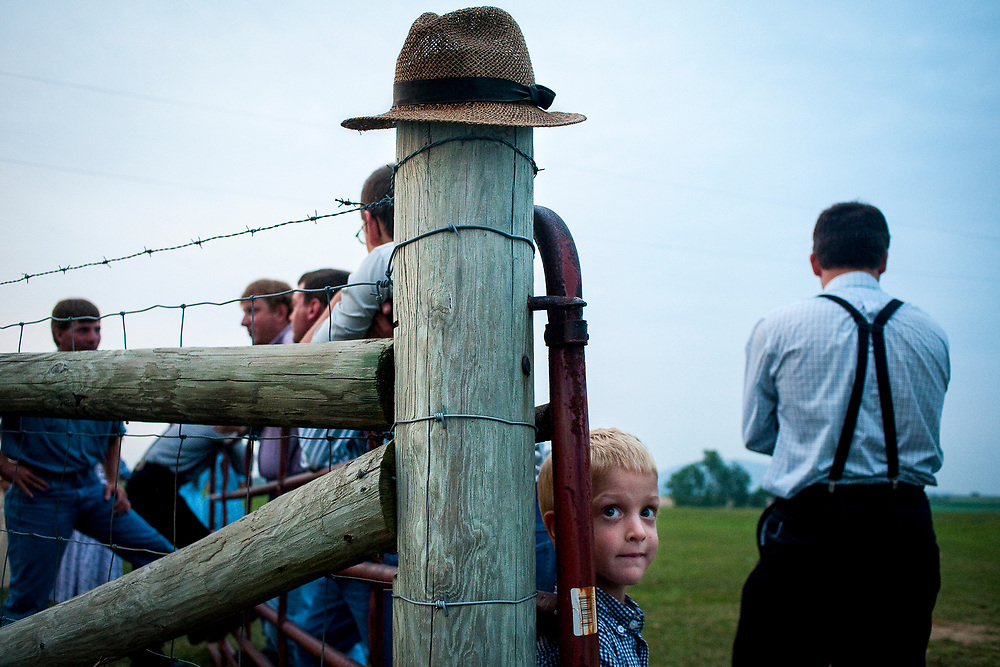 Jessie Rhodes hangs out with the men at a Mennonite youth night where they usually play softball and volleyball.