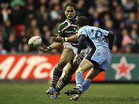 Photo: Rich Eaton.<br /> <br /> Leicester Tigers v Cardiff Blues. Heineken Cup. 13/01/2007.Alesana Tuilagi attacks for Leicester Tigers, about to be tackled by Nick Macleod of Cardiff