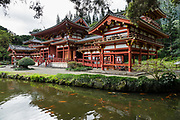 """The peaceful Byodo-In Temple is in Valley of the Temples Memorial Park, at 47-200 Kahekili Highway, Kaneohe, on the island of Oahu, Hawaii, USA. The Byodo-In Temple (""""Temple of Equality"""") was built in 1968 to commemorate the 100 year anniversary of the first Japanese immigrants to Hawaii. This Hawaii State Landmark is a non-practicing Buddhist temple which welcomes people of all faiths. The beautiful grounds at the foot of the Ko'olau Mountains include a large reflecting pond stocked with Japanese koi carp, meditation niches, and small waterfalls. Byodo-In Temple in O'ahu is a half-scale replica of the Byodo-in Temple built in 1053 in Uji, Japan (a UNESCO World Heritage Site)."""