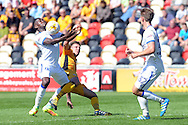 Mansfield's Mitchell Rose (l) controls the ball challenged by Newport's Mark Randall (c). Skybet EFL league two match, Newport county v Mansfield Town at Rodney Parade in Newport, South Wales on Saturday 6th August 2016.<br /> pic by Carl Robertson, Andrew Orchard sports photography.