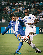 Guatemala forward Carlos Ruiz, left, has his shot blocked by Honduras defender Osman Chávez during the first half of a CONCACAF Gold Cup soccer match on Monday,  June 6, 2011 in Carson, Calif. (AP Photo/Bret Hartman)