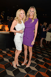 Left to right, EMMA SAYLE and LIZ McCLARNON at a party to celebrate the publication of Behind The Mask by Emma Sayle held at The Playboy Club, 14 Old Park Lane, London on 23rd April 2014.