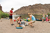 A paddling group stops for lunch while on a trip up The Colorado River through The Black Canyon, Nevada.