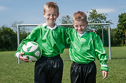 Two boys young soccer players posing portrait