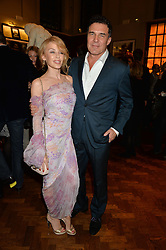 KYLIE MINOGUE and ANDRE BALAZS at a party to celebrate the launch of the Maison Assouline Flagship Store at 196a Piccadilly, London on 28th October 2014.  During the evening Valentino signed copies of his new book - At The Emperor's Table.