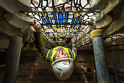 © Licensed to London News Pictures. 15/05/2019. York UK. Nick Teed prepares to remove a 600 year old stained glass window from York Minster. Work is starting today to protest 600 year old stained glass windows at York Minster as part of an £11 million conservation project. The major project to repair and maintain stone and stained glass in the cathedral's South Quire Aisle, which dates from the late 1300s, originally began in 2016, with activity to date focusing on replacing and conserving stonework. Specialist conservators from York Glaziers Trust are now beginning work to protect the area's medieval stained glass, starting with the removal of two windows from the upper Clerestory level. The windows, which date from the early 1400s and are approximately 70 feet from the ground, currently have no protection from the elements and are showing the signs of six centuries of exposure, with the glass having cracked and buckled in places allowing water in.Photo credit: Andrew McCaren/LNP