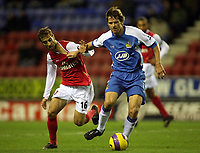 Photo: Paul Thomas.<br /> Wigan Athletic v Arsenal. The Barclays Premiership. 13/12/2006.<br /> <br /> Kevin Kilbane (R) of Wigan tries to get away from Mathieu Flamini.