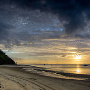 Frazer Island, on the east coast of Australia, is a sand island. Sunset seen from the jetty of Kingfisher Bay Resort.