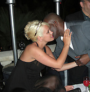 **EXCLUSIVE**.Singer Lily Allen & Mail on Sunday Reporter Baz Bamigboye.British GQ celebrate 'How To Lose Friends & Alienate People' party at Cannes Film Festival .Private Villa.Cannes, France.Thursday, May 15, 2008.Photo By Celebrityvibe.com.To license this image please call (212) 410 5354; or Email: celebrityvibe@gmail.com ;.website: www.celebrityvibe.com