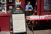 Heaps Sausage Cafe serve take away to customers on 15th April 2020 in Greenwich, London, United Kingdom. Chancellor of the Exchequer, Rishi Sunak has said the Office for Budget Responsibility OBR, the UKs tax and spending watchdog suggests the coronavirus crisis will have serious implications for the UK economy, warning the pandemic could see the economy shrink by a record 35% by June, increasing unemployment by over 2 million and sending the budget deficit to its highest since World War II.