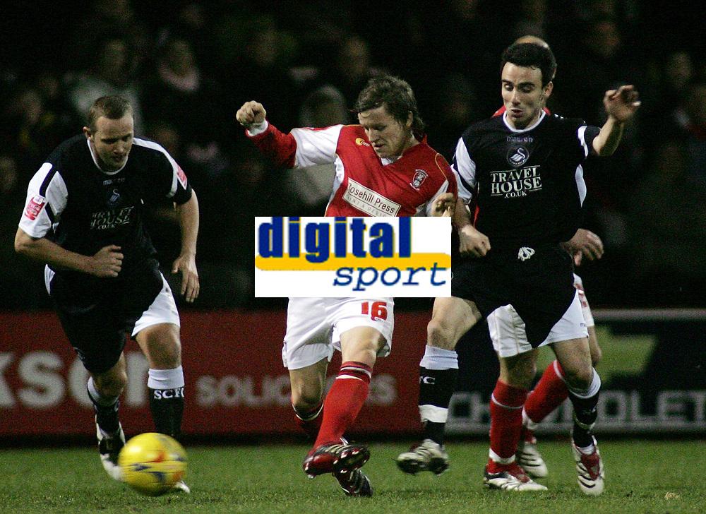Photo: Paul Thomas.<br /> Rotherham United v Swansea City. Coca Cola League 2. 27/02/2007.<br /> <br /> Leon Britton (R) of Swansea tries to catch Stephen Brogan (16).